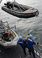 U.S. Sailors lower a Zodiac inflatable boat from the mine countermeasures ship USS Chief (MCM 14) in the East China Sea Oct. 20, 2014, in support of exercise Clear Horizon 2014 141020-N-UH865-011.jpg