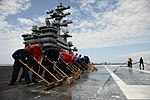 U.S. Sailors wash the flight deck of the aircraft carrier USS Ronald Reagan (CVN 76) July 22, 2013, while underway in the Pacific Ocean carrier qualifications 130722-N-ZZ999-115.jpg