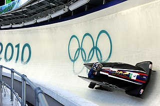 Bobsleigh winter sliding sport, where 2 or 4 participants propel a vehicle down a track of ice