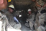 US Army Soldiers take cover after an indirect fire attack at Bagram Air Field 140926-A-QR427-017.jpg