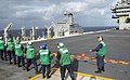 US Navy 021001-N-7265L-005 Line handlers control the messenger line aboard USS Carl Vinson (CVN 70).jpg