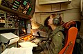US Navy 030509-N-6501M-018 Lt. j.g. Karensa L. Heidmiller operates the navigation station aboard a P-3C Orion aircraft during a mission to the Republic of the Philippines.jpg