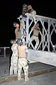 US Navy 030701-N-2517J-006 Seabees from Naval Mobile Construction Battalion On Thirty Three (NMCB-133) construct a bridge in Shabbad.jpg