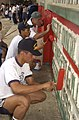 US Navy 030709-N-9251B-080 Naval Reservist, Capt. William Pincus, and Ecuadorian Sailors paint the walls of a school building.jpg