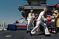 US Navy 030712-N-2383B-210 Crewmembers of the Navy's newest Nimitz-class aircraft carrier USS Ronald Reagan (CVN 76) keep with the Navy tradition of running up the gangplanks to bring the ship to life during the ship's co.jpg