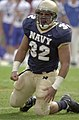 US Navy 031004-N-9693M-847 Navy fullback Kyle Eckel celebrates a rushing attempt against Air Force.jpg