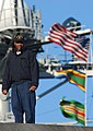US Navy 040120-N-0111R-001 A sailor stands on the fantail of the USS George Washington (CVN 73) for a last look at Norfolk, Va. before departing on a regularly scheduled deployment in support of the global war on terrorism.jpg