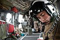 US Navy 050309-M-6717G-016 Hospital Corpsman 3rd Class Hessan, assigned to 3rd Battalion, 2nd Marine Division, flies onboard a Marine Corps CH-46E Sea Knight helicopter.jpg