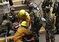 US Navy 050316-N-8604L-004 U.S. Navy Security personnel and firemen attached to Commander Naval Forces Japan regional fire department simulate a mass casualty drill held on board Commander Fleet Activities Yokosuka, Japan.jpg
