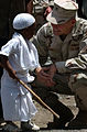 US Navy 060519-N-0411D-062 Commander of Combined Joint Task Force Horn of Africa, Rear Adm. Richard W. Hunt, visits with the 4-year old grandson of the Sultan of Tadjoura, Abdoulaker Moumat Houmed.jpg
