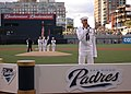 US Navy 060522-N-3349L-041 Air Traffic Controller 3rd Class John Phillips sings the national anthem prior to a Major League Baseball game between the San Diego Padres and Atlanta Braves at PETCO Park.jpg