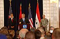 US Navy 060613-N-0000X-002 U.S. Ambassador to Iraq Zalmay Khalilzad, left, and Commanding General, Multinational Forces-Iraq Gen. George Casey, right, listen to U.S. President George W. Bush.jpg