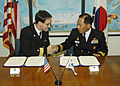 US Navy 061108-N-4649C-001 Commander, Submarine Group Seven Rear Adm. John Bird (left), shakes hands with Commander, Korean Submarine Force Rear Adm. Il Heon Bae, after signing the Mutual Logistics Support Agreement.jpg