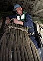 US Navy 070130-N-5567K-005 Boatswain's Mate 3rd Class Trent Shuler of Dolan Springs, Ariz., coils and stows mooring lines used for Landing Craft Air Cushion operations in the well deck.jpg