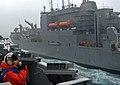 US Navy 070207-N-8923M-016 Operations Specialist 3rd Class Jeana Mullen talks on a sound-powered telephone as Nimitz-class aircraft carrier USS Harry S. Truman (CVN 75) pulls alongside Military Sealift Command (MSC) dry cargo-a.jpg
