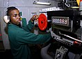 US Navy 070413-N-8446A-003 Aviation Boatswain's Mate Airman Leonid Peets sets the arresting aircraft weight while manning an arresting gear engine aboard the Nimitz-class aircraft carrier USS Dwight D. Eisenhower (CVN 69).jpg