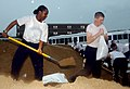 US Navy 070823-N-0606B-003 Seaman Kayla Days and Seaman Alex Mills, students at Naval Hospital Corps School, fill sandbags for delivery to homes and businesses.jpg