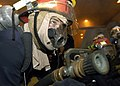 US Navy 070927-N-5681S-012 Boatswain's Mate 3rd Class Cory Barber, of Traverse City, Mich., simulates fighting a mock fire aboard nuclear-powered aircraft carrier USS Enterprise (CVN 65) during a general quarters drill.jpg