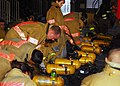 US Navy 071024-N-2638R-007 Sailors assigned to the submarine tender USS Frank Cable (AS 40), prepare their self-contained breathing apparatuses (SCBA) during an advanced shipboard fire fighting class at the Center for Naval Eng.jpg