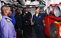 US Navy 071101-N-8933S-015 Damage Controlman 2nd Class Adam Burg talks about the Ram Fans used to remove smoke from an area after a fire is extinguished to Nigerian Sailors.jpg