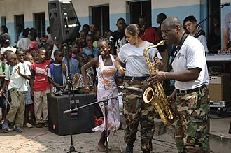 Music of Gabon - A student from Belise Elementary School dances to music from members of the Africa Partnership Station band
