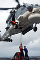 US Navy 080612-N-8138M-222 Hull Technician 3rd Class Josh Borel, left, attaches cargo to a Royal Thai Navy SH-70 helicopter aboard the guided-missile frigate USS Ford (FFG54) as Boatswain's Mate 3rd Class Tabari Nakenge acts as.jpg