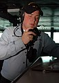 US Navy 080803-N-9116H-002 Seaman Christopher Wallace uses a sound-powered phone.jpg