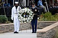 US Navy 080911-N-0616M-006 Members of a joint service honor guard carry a wreath toward the Pentagon Memorial Sept. 11, 2008, during its dedication ceremony.jpg