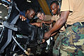 US Navy 090108-N-9995B-004 Chief Master at Arms Kurtis Chapman, center, assigned to Expeditionary Training Command, assists members of the Jamaica Defense Force in troubleshooting a small boat outboard engine during a Southern.jpg