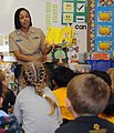 US Navy 090303-N-3666S-011 Boatswain's Mate 2nd Class Rasheema Newsome, assigned to Commander, Navy Region Hawaii, reads Dr. Seuss' The Cat in the Hat to kindergarten students at Lehua Elementary School.jpg