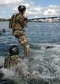 US Navy 090305-N-5366K-025 A Special Warfare Combatant-craft Crewman candidate jumps into Coronado Bay for a floatation check.jpg