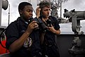 US Navy 090407-N-6538W-284 Seaman Nathaniel Anderson, right, from Spring Hill, Tenn., and Boatswain's Mate Seaman Recruit Courtney Pollard, from Fort Worth, Texas, use a sound powered phone to report surface contacts.jpg
