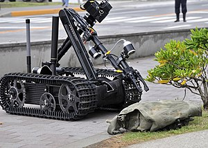 Counter-IED equipment - US Navy 090512-N-2013O-013 A Mark II Talon robot from Explosive Ordnance Disposal Mobile Unit 5, Det. Japan, is used to inspect a suspicious package during a force protection-anti-terrorism training exercise