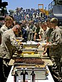 US Navy 090621-N-5345W-005 Sailors and Marines line up for a steak and lobster feast during a Father's Day steel beach picnic.jpg