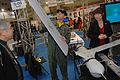 US Navy 091104-N-3283P-263 Lt. Jacob Baker, the logistics planning officer for Commander, U.S. Naval Forces Japan, removes the wing of a Scan Eagle unmanned aerial vehicle (UAV) to show spectators the compactness of UAVs.jpg