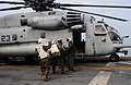 US Navy 100119-N-7508R-044 Marines load water onto a CH-53E Super Stallion helicopter aboard USS Bataan (LHD 5).jpg