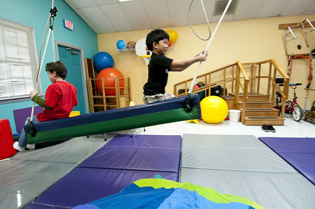 US Navy 100306-N-5319A-056 Ten-year-old Joseph Camano, right, and therapy patient nine-year-old Logan Flaathen work together to swing in the Diane Epplein ^ Assoc. Pediatric Therapy facility gymnasium during a routine physical