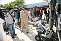 US Navy 100324-N-3271W-051 Chief Explosive Ordnance Disposal Technician Sean O'Leary shows a student at Carl Hayden High School a remote-controlled robot.jpg