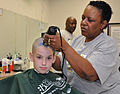 US Navy 100327-N-2541H-001 A little boy has his head shaved by a Navy Exchange barber during a St. Baldrick's Day fundraiser at Naval Medical Center Portsmouth.jpg