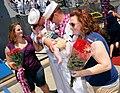 US Navy 100423-N-3666S-067 Sailors greet their newborn children upon returning to Joint Base Pearl Harbor-Hickam.jpg