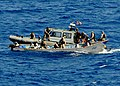 US Navy 100427-N-1082Z-158 he visit, board, search and seizure team assigned to USS Ashland (LSD 48) inspects a skiff for suspected pirate activity.jpg
