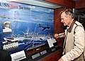 US Navy 100715-N-3885H-006 Former President George H.W. Bush looks at a display of his former ship, the aircraft carrier USS San Jacinto (CVL 30), in the tribute room of the aircraft carrier that bears his name, USS George H.W.jpg