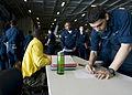 US Navy 101205-N-9626Y-007 Aviation Structural Mechanic Airman Jonathon Darragh, right, from Jacksonville, Fla., signs up for a warfare walk-throug.jpg