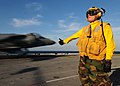US Navy 110202-N-5538K-097 Aviation Boatswain's Mate Airman Jeremy J. New gives the okay signal as an AV-8B Harrier jet aircraft.jpg