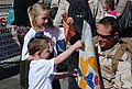 US Navy 110222-N-WE331-039 A Sailor is welcomed home by his family during a homecoming celebration.jpg