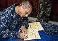 US Navy 110722-N-OV802-124 Cmdr. Angel Cruz signs graduate certificates for the Africa Partnership Station (APS) East Kenya Hub graduation ceremony.jpg