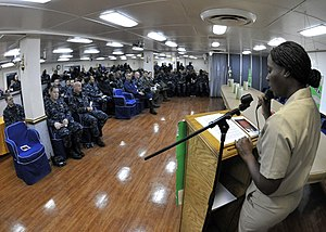 US Navy 120113-N-KM939-034 Chief Aviation Ordnanceman Mattie Hackney, from Daytona Beach, Fla., addresses Sailors aboard the nuclear-powered aircra.jpg