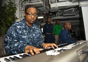 US Navy 120123-N-FI736-131 Information Systems Technician 3rd Class Kentara Gillard plays music during a Dr. Martin Luther King, Jr. birthday celeb.jpg