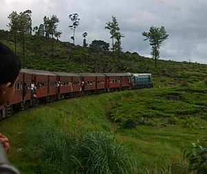 An intercity train, the Udarata Menike, runs through the scenic Sri Lankan hill country