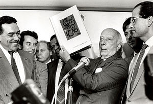 Ulysses Guimarães - Ulysses Guimarães holding the final draft of the 1988 Constitution.